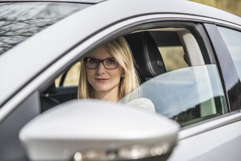 Portrait of confident woman in car - CHPF00376