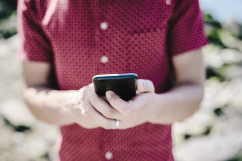 Close-up of man using cell phone - GIOF02402