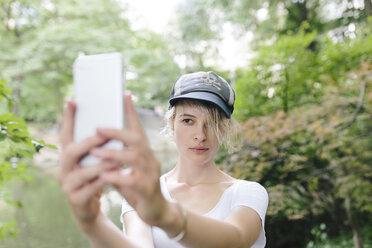Young woman taking a selfie in park - BOYF00734