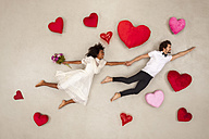 Young couple falling in love with hearts around - BAEF01262
