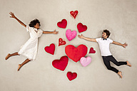 Young couple falling in love with hearts around - BAEF01265