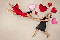 Lesbian couple spinning with joy - BAEF01289