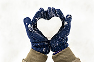 Snow heart on hands with gloves - MGOF03082