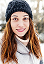 Portrait of a beautiful woman outdoors in winter - MGOF03088