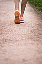 Close-up of running woman - KKAF00536