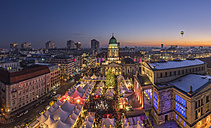 Germany, Berlin, Christmas market at Gendarmenmarkt in the evening - PVCF01041