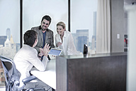 People working together on tablet in office - ZEF13169