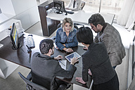 People working together on tablet in office - ZEF13178