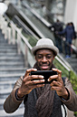 Man taking selfie with smartphone, close-up - MAUF00987