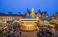 Germany, Frankfurt, rotating carousel on Christmas market at Roemerberg in the evening - PVCF01049