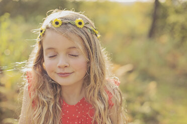 Portrait of relaxed little girl with eyes closed wearing flower wreath - NMSF00030