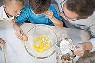 Father and two boys baking in kitchen - ZEF13220