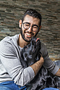 Portrait of man with his dog at home - TCF05328