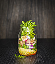 Preserving jar of buckwheat salad with vegetables, coconut chips and diced Striploin Steak - KSWF01795
