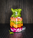 Preserving jar of salad with vegetables and salmon - KSWF01798