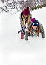 Two best friends having fun in the snow - MGOF03142