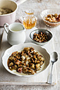 Bowl of porridge with rhubarb compote, honey and nuts - EVGF03157