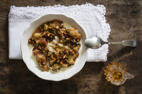 Bowl of porridge with rhubarb compote, honey and nuts - EVGF03160