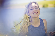 Portrait of smiling young woman outdoors - ZEF13239