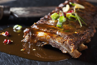 Marinated and grilled spare ribs with Barbecue sauce on slate - CSF28220
