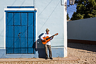 Cuba, man playing guitar on the street - MAUF01034