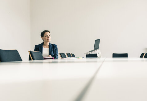 Businesswoman working in conference room - UUF10252