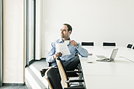 Confident businessman in conference room - UUF10270