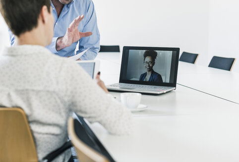 Business people having a video conference in office - UUF10276