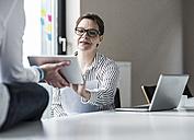 Businesswoman and businessman working in conference room - UUF10288