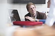 Business people brainstorming in a team meeting in office - ZEF13260