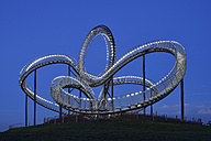 Germany, Duisburg, View of illuminated Tiger and Turtle art installation at Angerpark - RUE01767