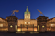 Germany, Berlin, Charlottenburg, Charlottenburg Palace with entrance gate and statues illuminated - RUE01776