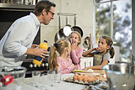 Family cooking together in kitchen - ZEF13303