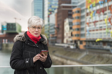 Germany, Duesseldorf, portrait of senior woman with cell phone - FRF00500