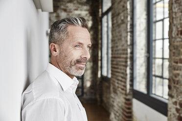 Portrait of confident businessman - FMKF03680