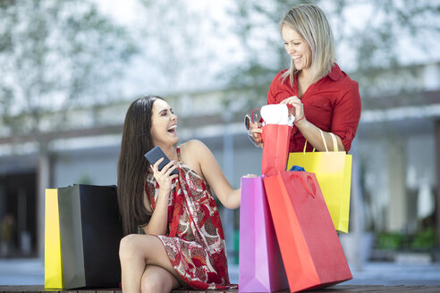 Two happy women with shopping bags - ZEF13385