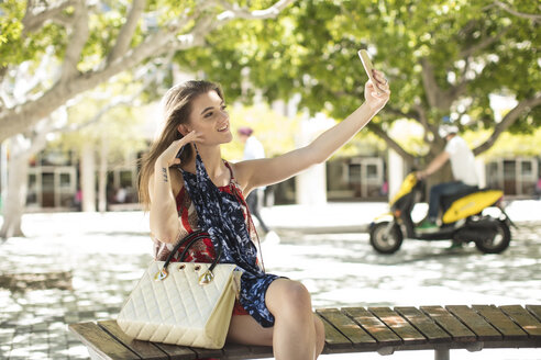 Fashionable woman taking a selfie in the city - ZEF13406