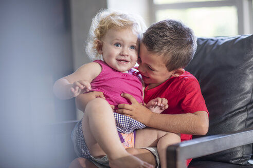 Brother and baby girl on armchair having fun - ZEF13450