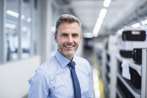 Portrait of a manager on the shop floor of a factory - DIGF01674