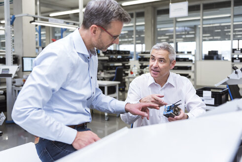 Two managers discussing product in company - DIGF01686