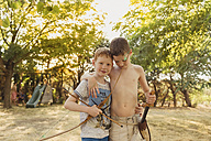 Boys playing with bow and arrows - NMSF00038