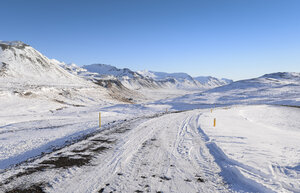 Iceland, winter landscape with road - RAEF01774