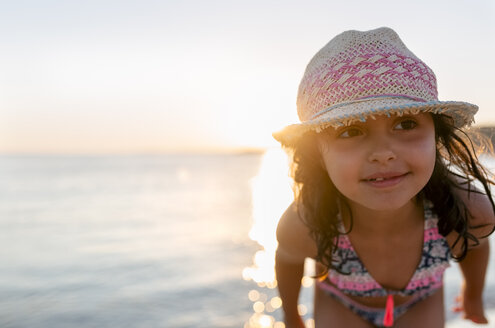Spain, Menorca, girl on the beach at sunset - MGOF03174