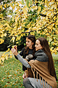 Young woman and little girl in autumn - CHAF01816