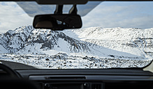 Iceland, snow-capped mountain seen from inside car - EPF00415