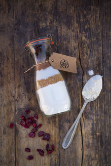Glass bottle with ingredients of baking mix for cranberry chocolate cake - LVF05976