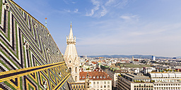 Austria, Vienna, cityscape with colored roof tiles and Stephansdom - WD03970