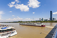 Austria, Vienna, cruise liner on Danube,  Donau City with Donauturm and DC Tower 1 - WD03985