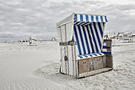 Germany, Schleswig-Holstein, St Peter-Ording, hooded beach chair - RORF00708