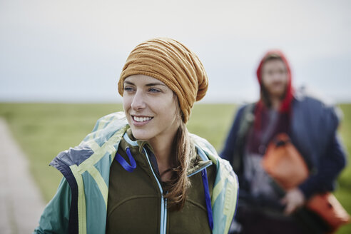 Smiling woman with man in background on a trip - RORF00738